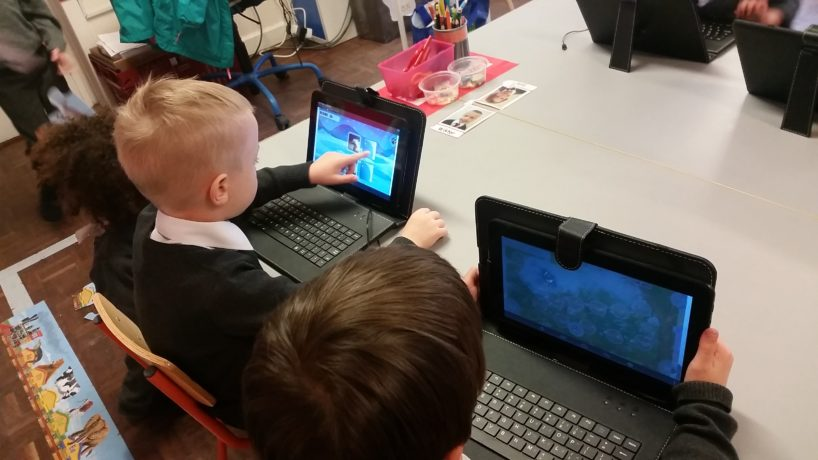 Junior Infants Getting to Grips with the Tablets
